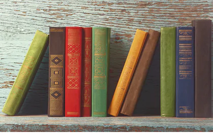old-books-on-background-wooden-260nw-522019972.jpg